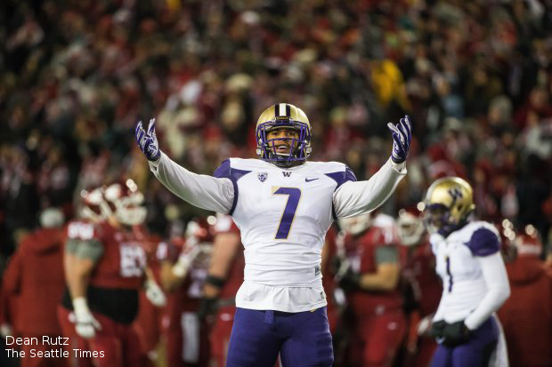 112914 - PULLMAN, WA - Washington linebacker Shaq Thompson tries to get the Husky fans into the game in the first quarter Saturday against Washington State. (UWFootball30)